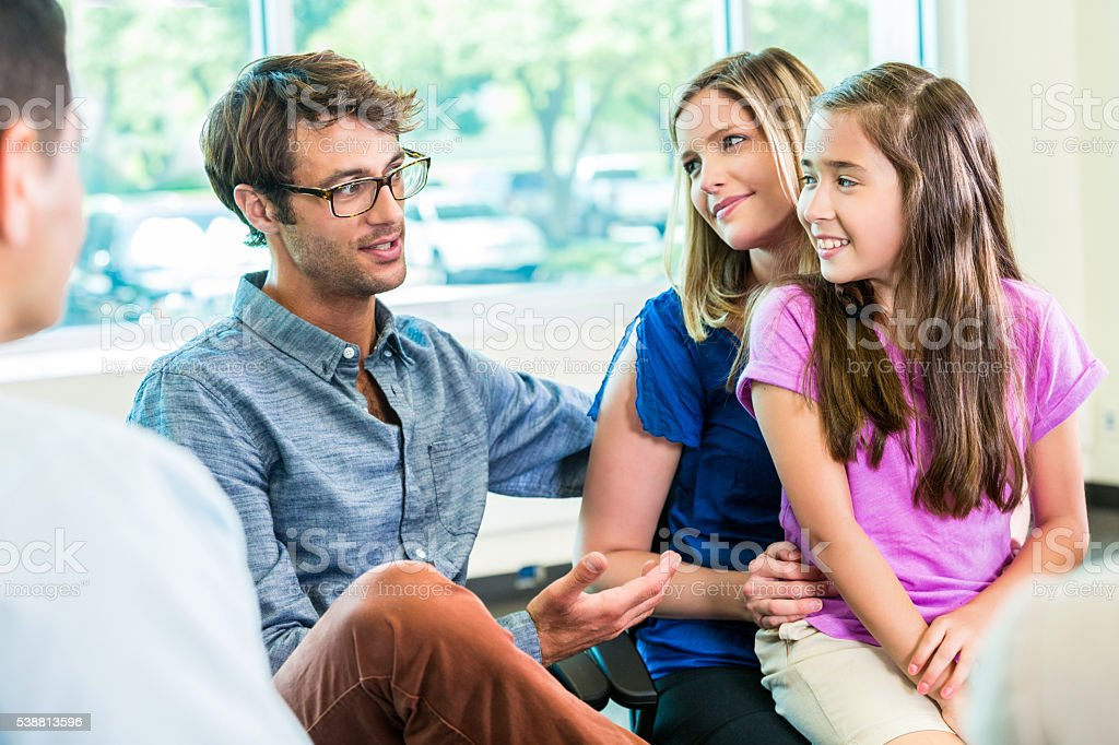 Happy family at guidance counseling stock photo