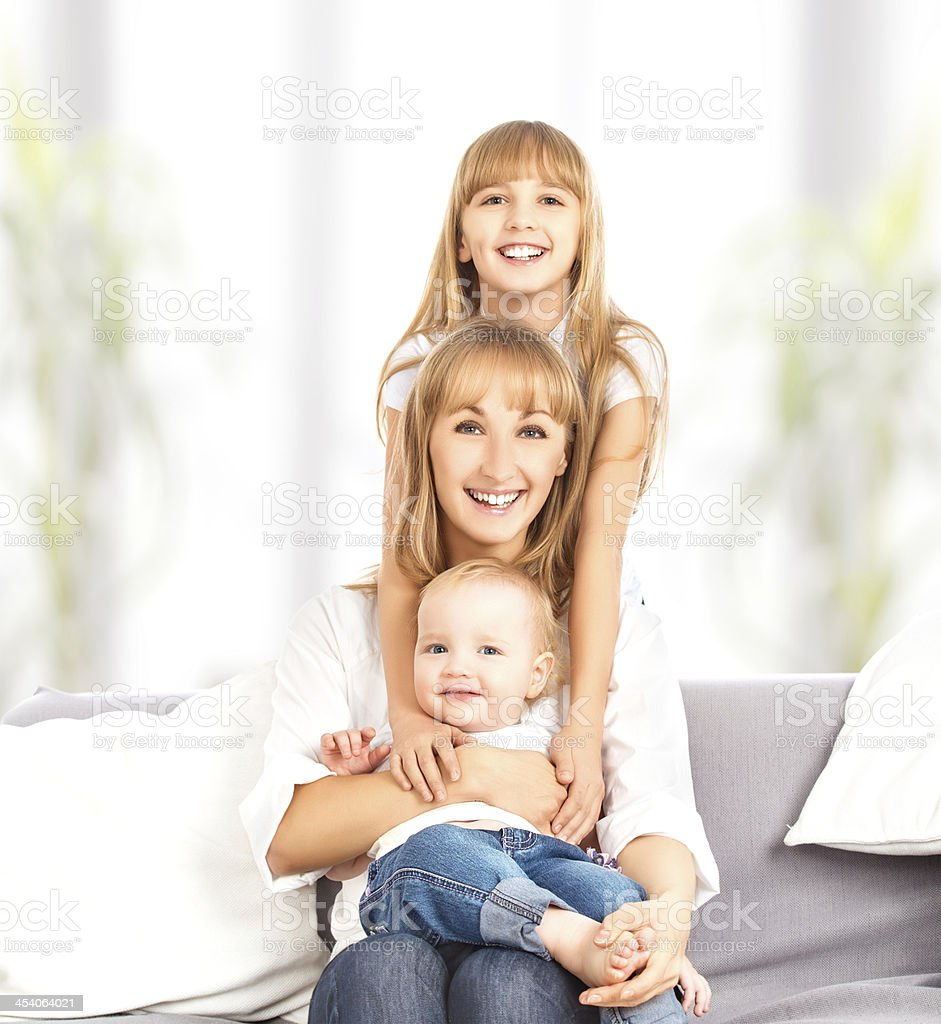 happy family at home on couch. royalty-free stock photo