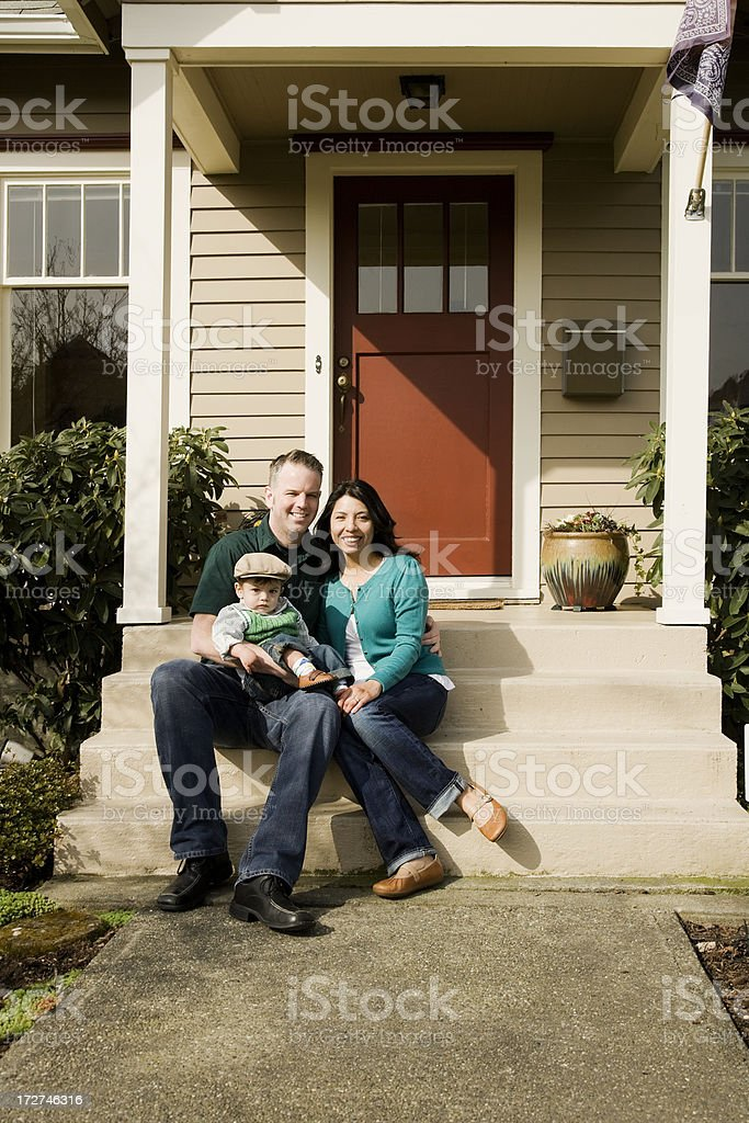 Happy Family at Home on Front Porch royalty-free stock photo