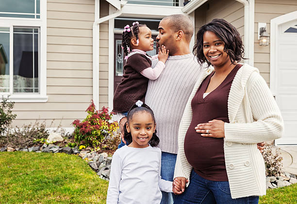 Happy Family at Home with Baby on The Way stock photo