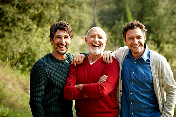 happy family at park - drie personen stockfoto's en -beelden