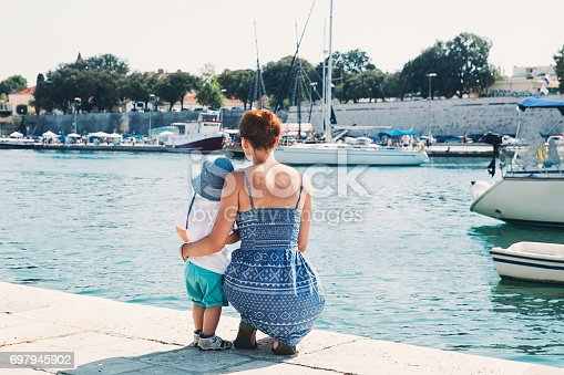 istock Happy family at summer time in Zadar, Croatia. 697945902
