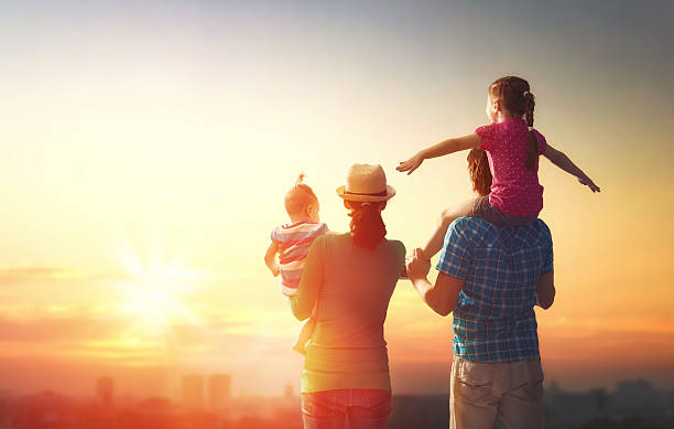 happy family at sunset. stock photo