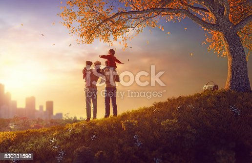 istock Happy family at sunset 830231596