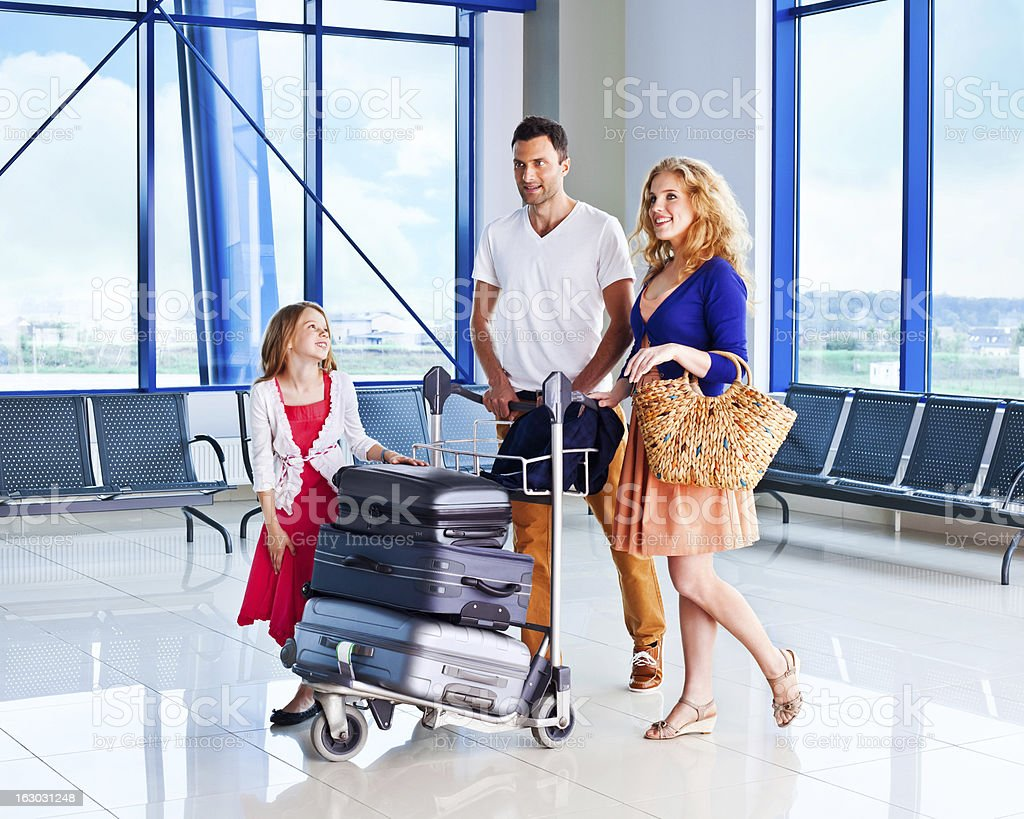 Happy family at the airport stock photo