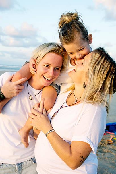Happy family at the beach stock photo