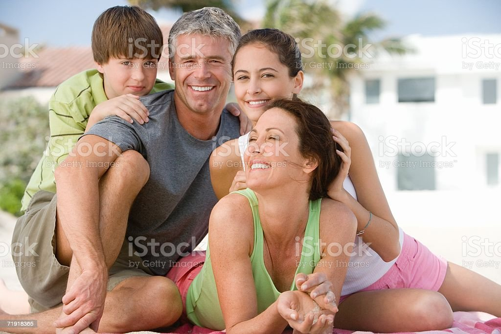 Happy family at the beach royalty-free stock photo