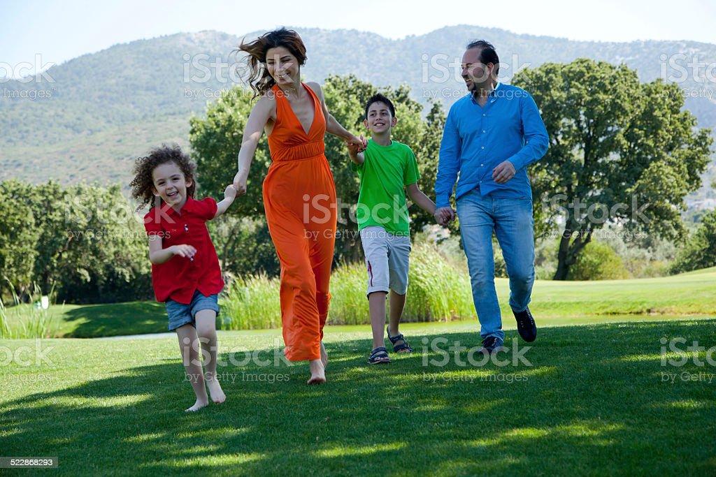 Happy family at the park stock photo