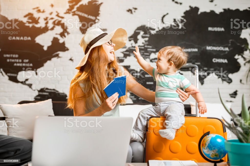 Happy family at the travel agency office royalty-free stock photo