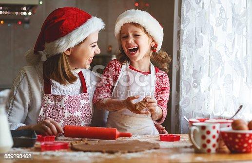 istock happy family bake christmas cookies 859293462