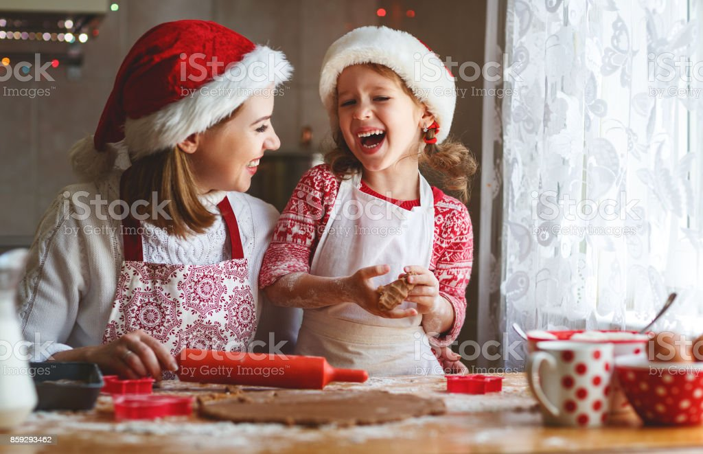 happy family bake christmas cookies stock photo