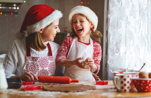 happy family bake christmas cookies - christmas cookies stock pictures, royalty-free photos & images