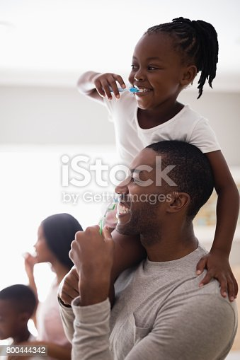 800444456 istock photo Happy family brushing teeth in bathroom 800444342
