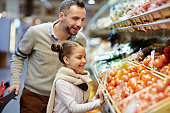 istock Happy Family Buying Fresh Vegetables 685863334