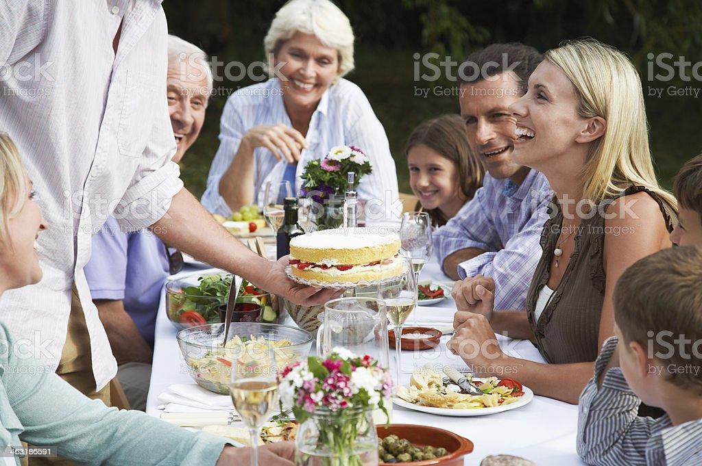 Happy Family Celebrating Birthday Outdoors royalty-free stock photo