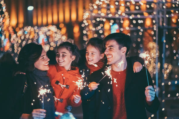 Happy family celebrating Christmas and New Year together stock photo