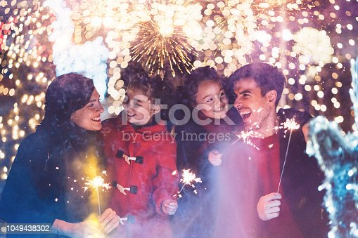Family with two daughters enjoying New Year
