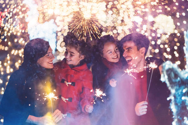 Happy family celebrating Christmas stock photo