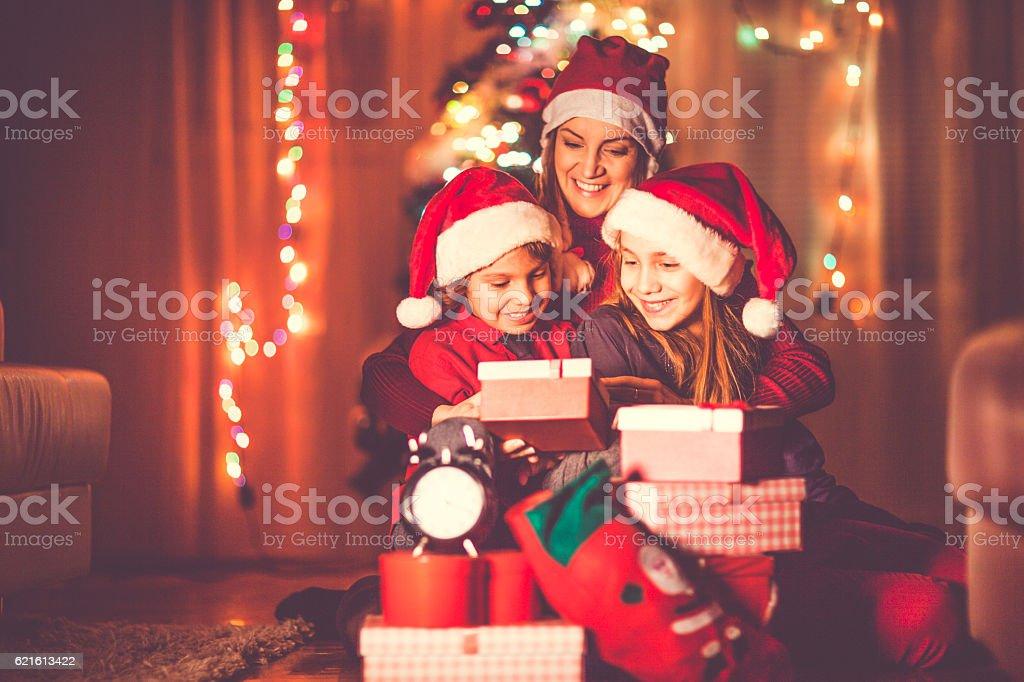 Happy family celebrating Christmas stock photo