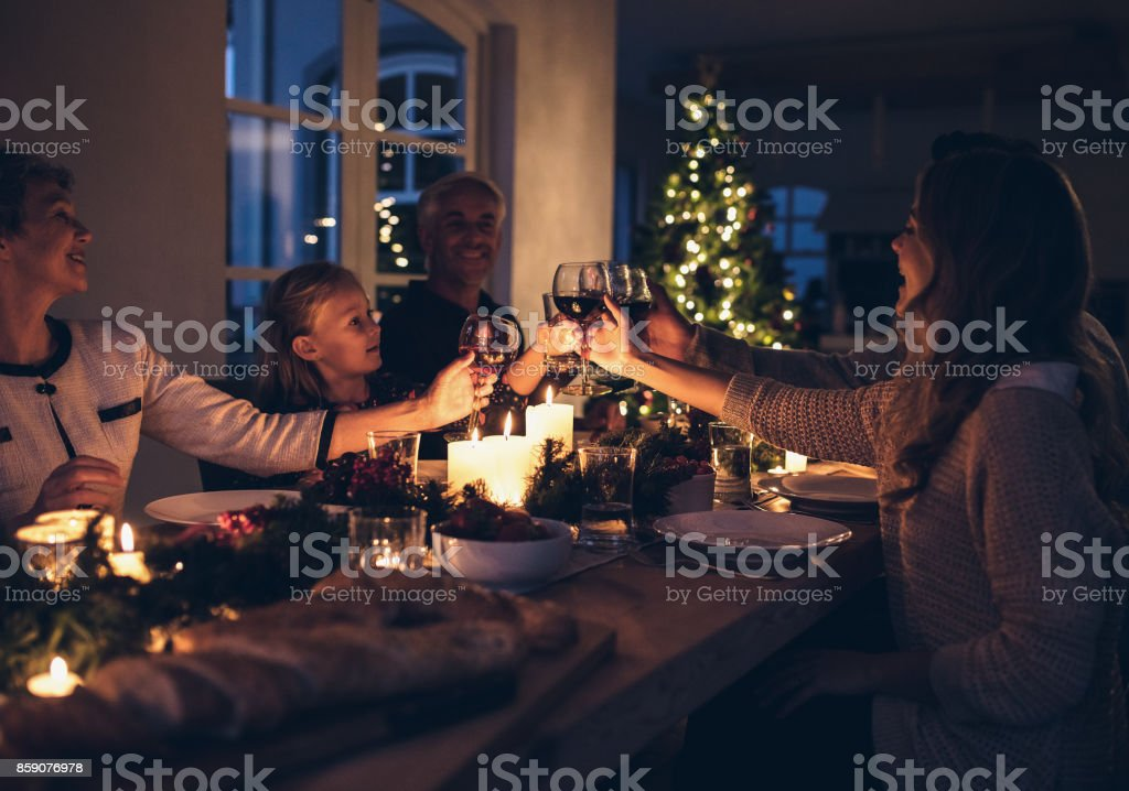 Happy family celebrating christmas together at home stock photo