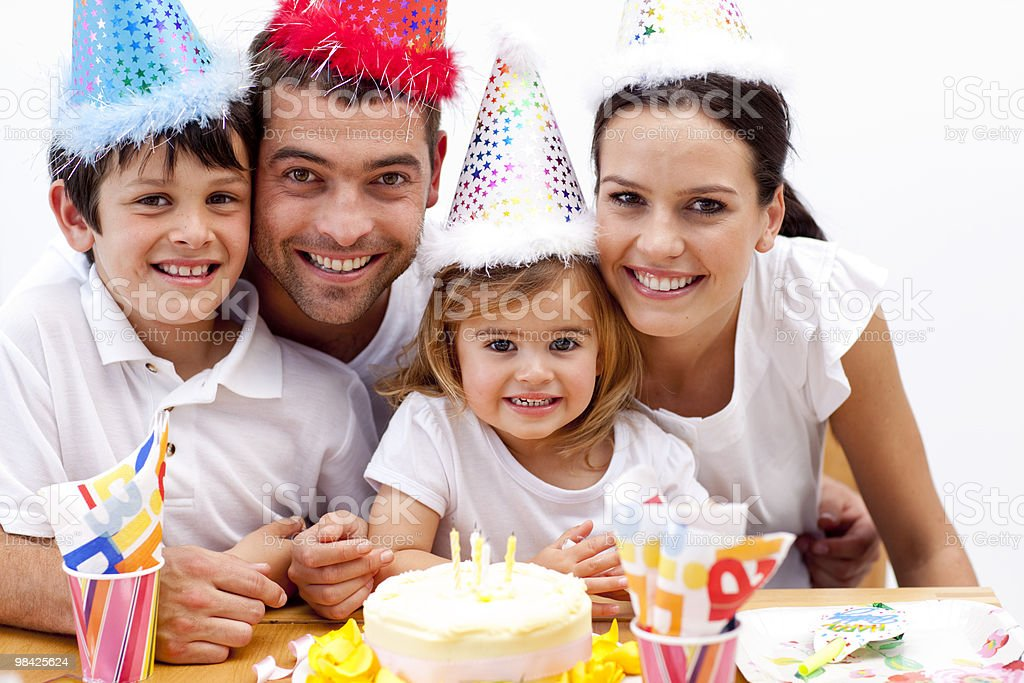 Happy family celebrating daughter's birthday royalty-free stock photo