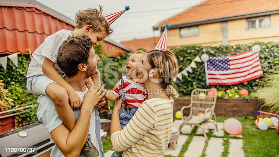 istock Happy family celebrating Fourth of July 1199700737