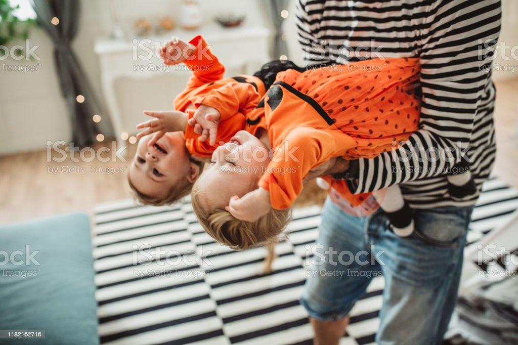 Happy family celebrating Halloween - Royalty-free 12-17 Months Stock Photo