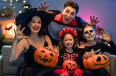 istock Happy family celebrating Halloween 1279825821