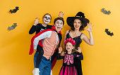 istock Happy family celebrating Halloween. 1279905123