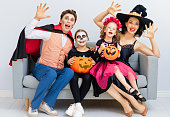 istock Happy family celebrating Halloween. 1279905131