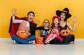 istock Happy family celebrating Halloween. 1279905144