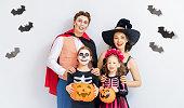 istock Happy family celebrating Halloween. 1279905147