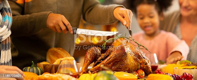 istock Happy Family Celebrating Thanksgiving Dinner at home . Celebration tradition concept 1185723401