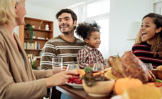 istock Happy Family Celebrating Thanksgiving Dinner at home  .Thanksgiving Celebration tradition concept 1179214321