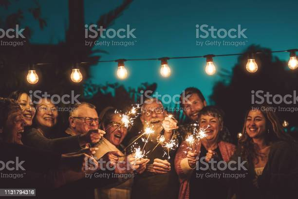 Happy family celebrating with sparkler at night party outdoor group picture id1131794316?b=1&k=6&m=1131794316&s=612x612&h=cftnurovssmv2mdpyef1cyx1nhqewpmatp8kpjwu1nc=