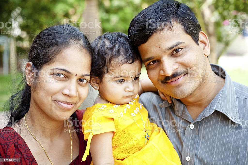 Happy Family Cheerful Young Indian Couple royalty-free stock photo