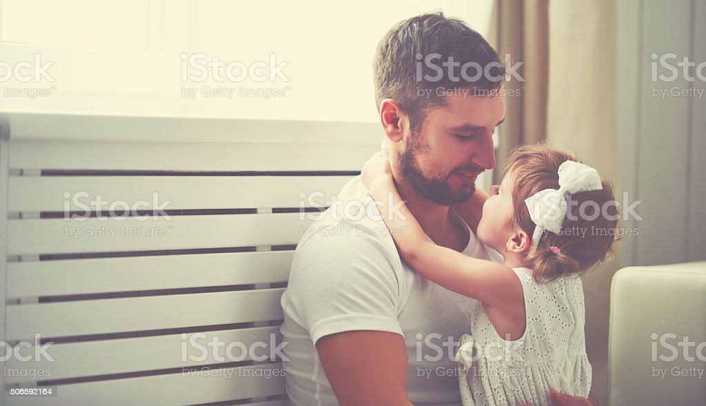 happy family child baby girl in arms of his father stock photo