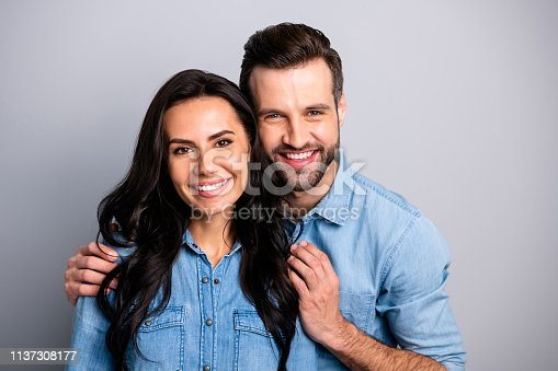 Happy family! Close up photo of adorable affectionate cute family bonding warm comfort cozy cuddles sharing smiles happiness satisfaction memories in blue denim shirts isolated on silver background.
