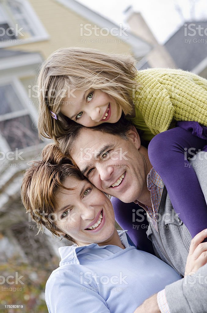 Happy Family Close-up in Front of Home royalty-free stock photo