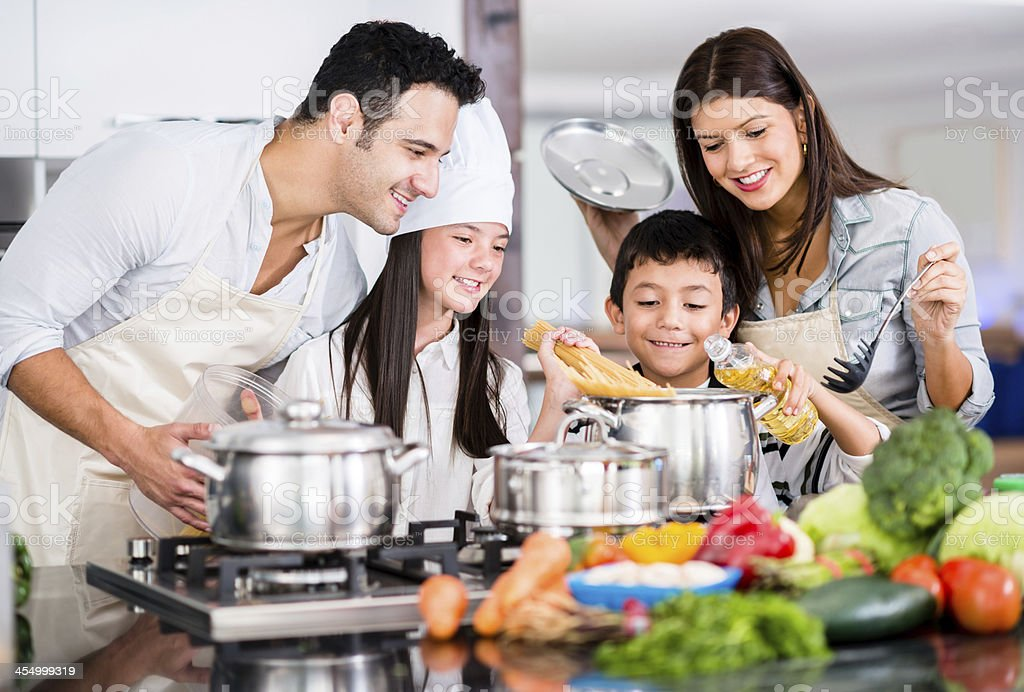 Happy family cooking stock photo more pictures of adult for Cocina en familia canal cocina