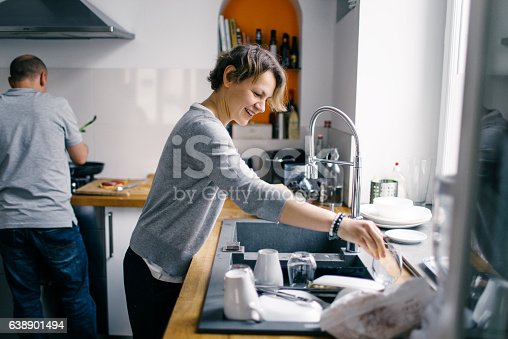 istock Happy family cooking together at home 638901494