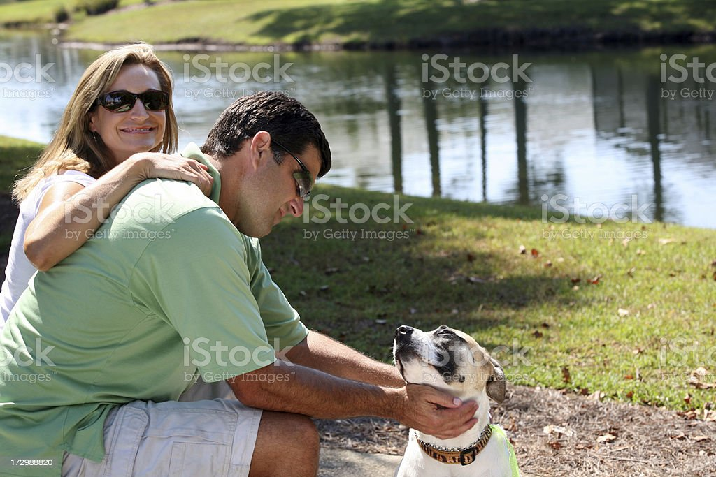 Happy Family  Couple with Loving Pet Dog royalty-free stock photo