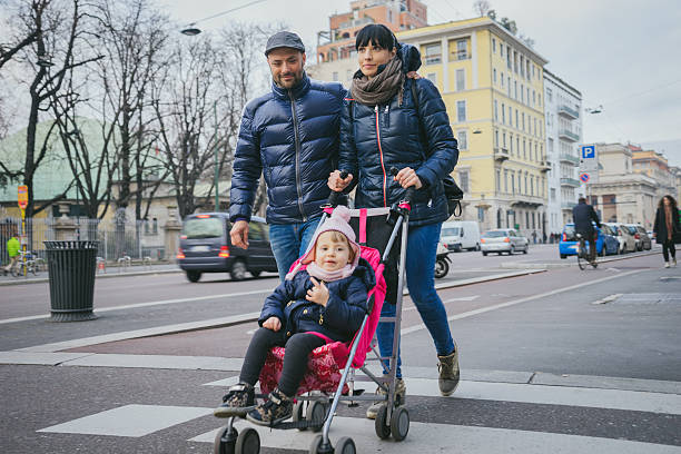 Happy Family Crossing The Street stock photo