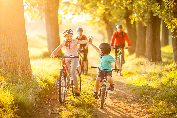 Happy family cycling in the countryside - foto stock