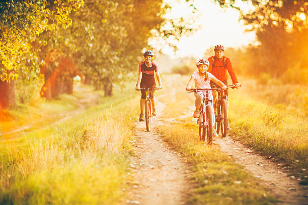 Happy family cycling in the countryside – Foto