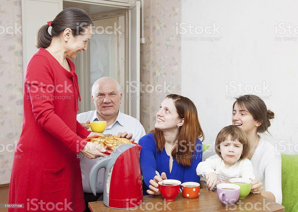 happy   family drinks tea and eats cakes royalty-free stock photo