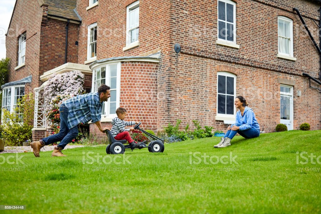 Happy family enjoying in backyard stock photo
