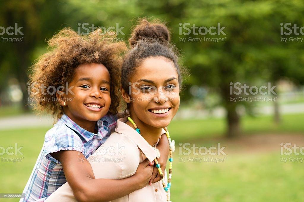 Happy family enjoying in the nature. stock photo