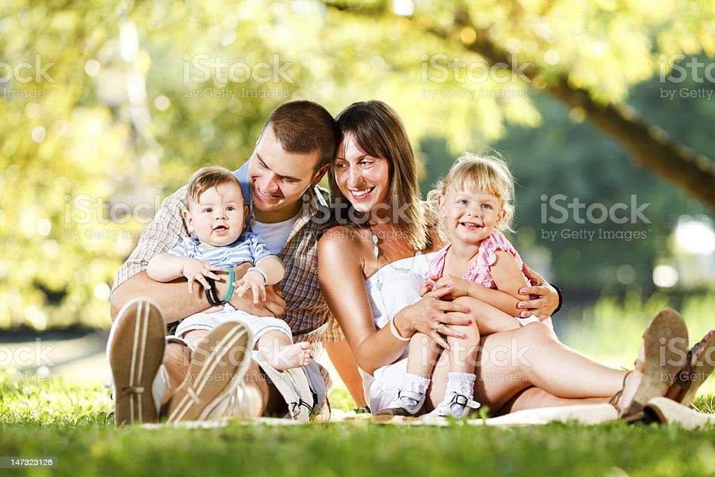 Happy family enjoying in the park royalty-free stock photo