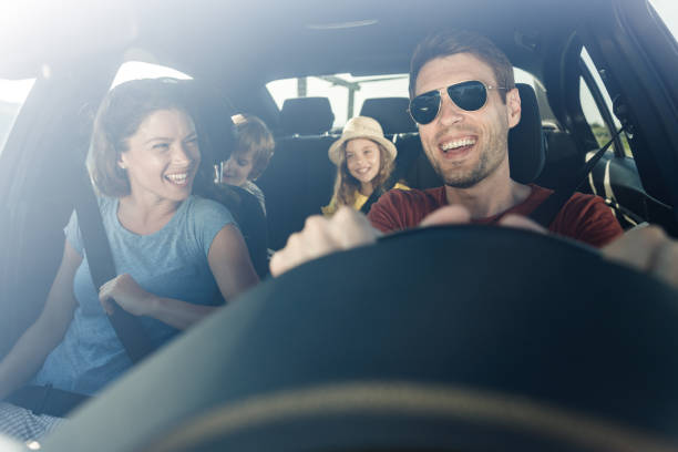Happy family enjoying in their trip by car. stock photo